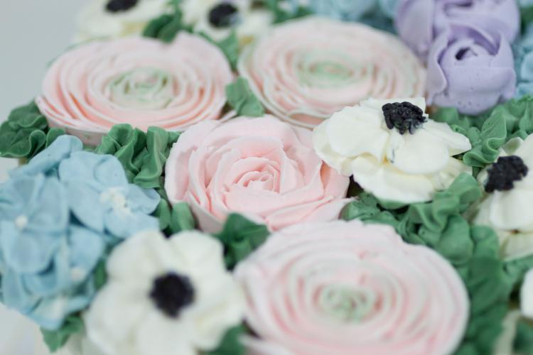 Buttercream floral cake by Whipped Bakeshop